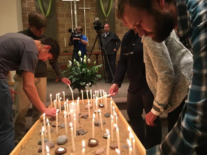 Nathan, etc. lighting candles